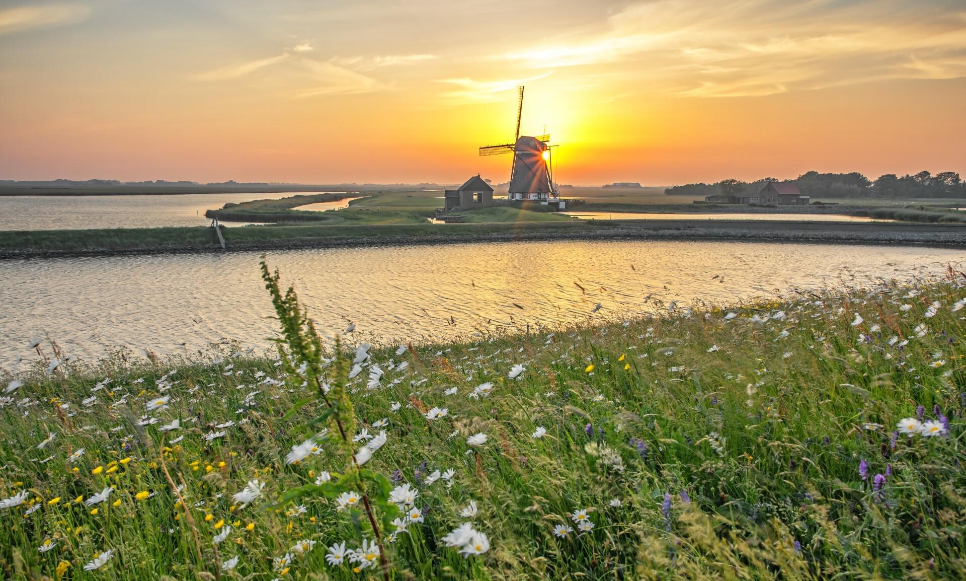 Molen het Noorden met de zonsondergang VVV Texel fotograaf Justin Sinner